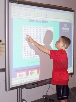 student-using-interactive-whiteboard